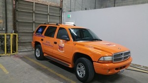 Water Damage Restoration SUV Parked