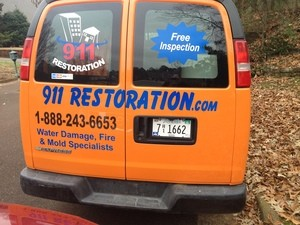 Water Damage Restoration Rear Of Van At Residential Job