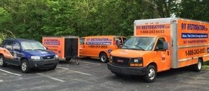 Water Damage and Mold Removal Trucks Getting Ready For Remediation Job